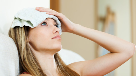 girl with wet towel on forehead